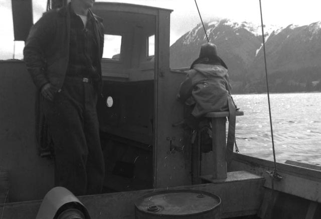 Young boy at the helm of a fishing boat. Ouzinkie area, ca. 1940. Courtsey Tim and Norman Smith.