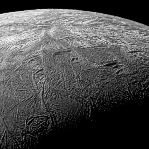 This is a close-up view of the fractures on Enceladus taken by Cassini during its flyby Nov. 21, 2009. The area, about 504 kilometers (313 miles) across, focuses on Baghdad Sulcus, a fracture in the south polar region. Image Credit: NASA/JPL/SSI