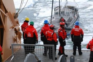 Coast Guard Cutter Healy crewmembers make contact with a mariner aboard his 36-foot sailboat trapped in Arctic ice approximately 40 miles northeast of Barrow, Alaska, July 12, 2014. U.S. Coast Guard photo courtesy of Coast Guard Cutter Healy.