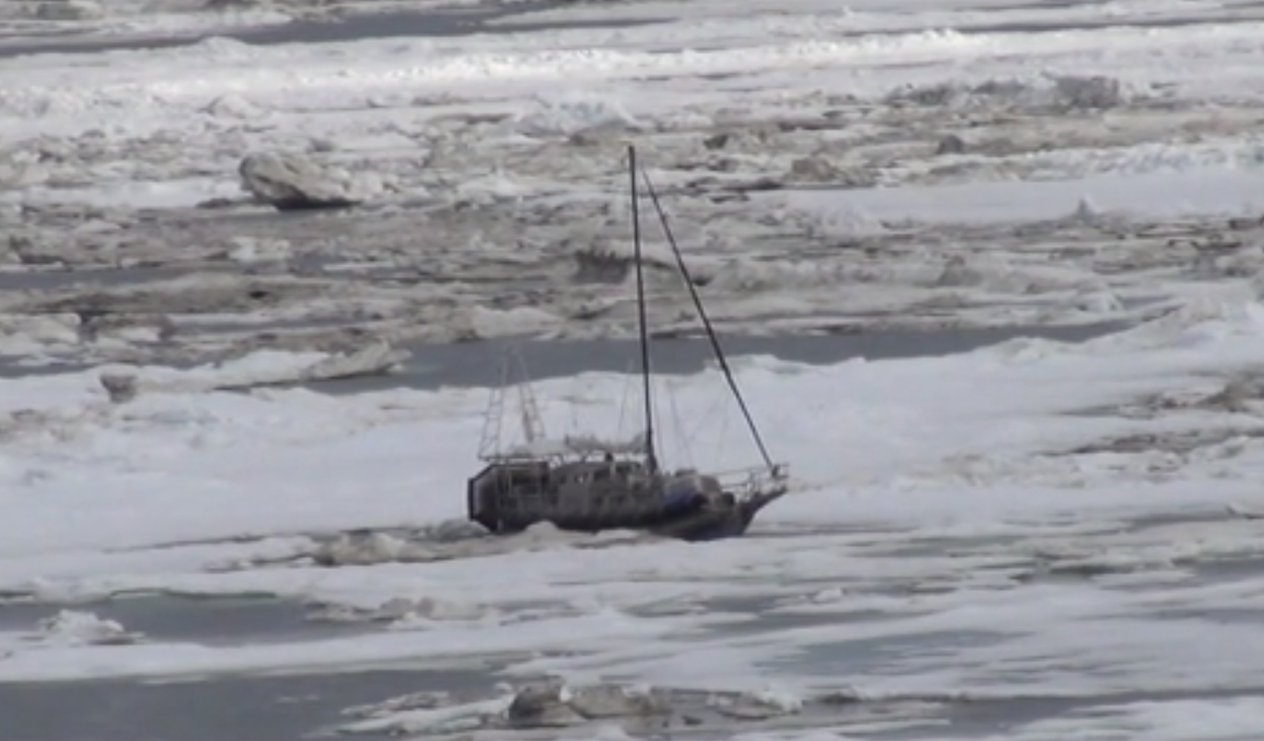 The 36-foot sailboat Altan Girl trapped in arctic ice. Image-USCG