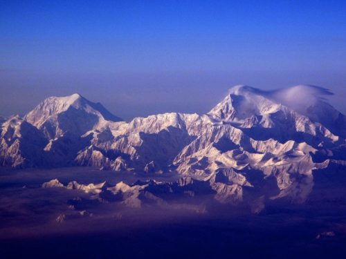 The snow-capturing peaks of the Alaska Range, including 17,400 foot Mount Foraker, left, and 20,320 foot Mount McKinley. Photo by Ned Rozell.