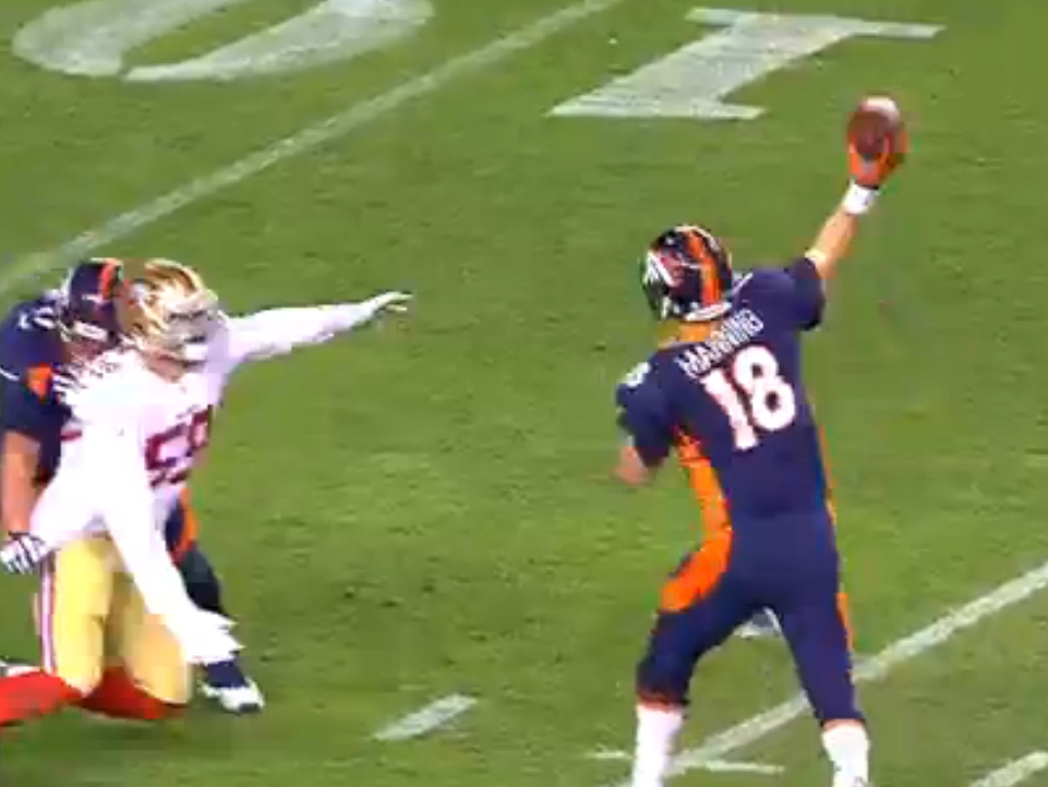 Denver Bronco Quarterback Peyton Manning launching his 509th career touchdown pass to break the record on Sunday night.