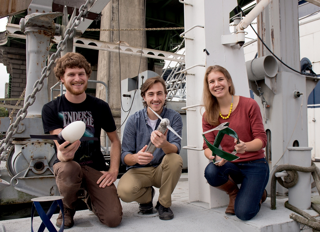 UW mechanical engineering graduate students Ben Strom, John Bates and Emma Cotter hold competing designs for tidal turbine prototypes.Mary Levin / UW