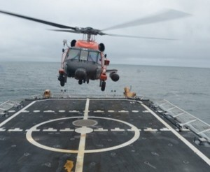 A Coast Guard Air Station Kodiak MH-60 Jayhawk helicopter crew takes off from the flight deck of the Coast Guard Cutter Stratton while underway in the Chukchi Sea Sept. 10, 2014.(U.S. Coast Guard photo by Petty Officer 2nd Class Grant DeVuyst)