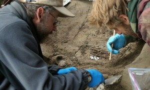 UAF photo courtesy of Ben Potter University of Alaska Fairbanks professors Ben Potter and Josh Reuther excavate the burial pit at the Upward Sun River site.