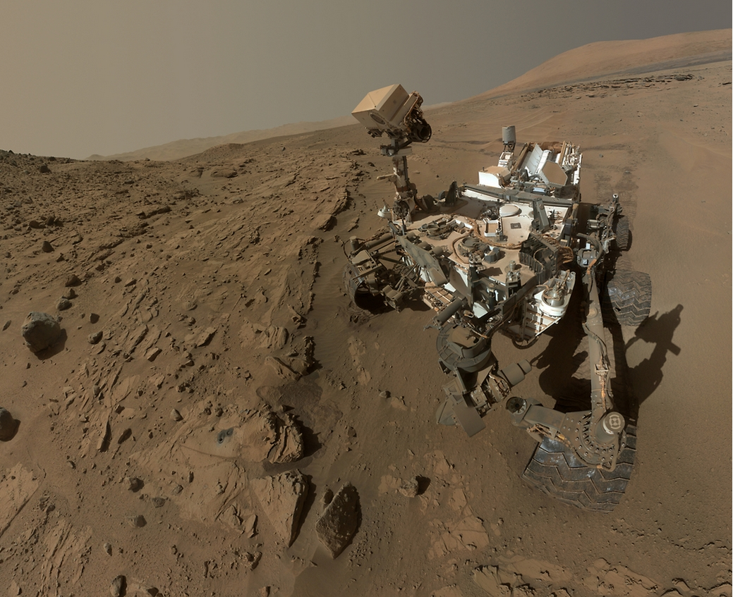 A self-portrait taken by the car-size Curiosity rover on the surface of Mars in April/May 2014. Image courtesy NASA/JPL-Caltech/MSSS.