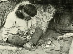 Alaska Native ivory worker circa 1910.