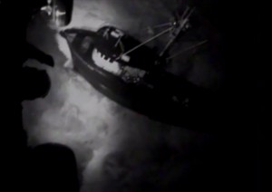 A Coast Guard Air Station Kodiak MH-60 Jayhawk helicopter crew hoists four fishermen from the fishing vessel Savannah Ray after they ran aground in Chiniak Bay near Kodiak. Image-USCG