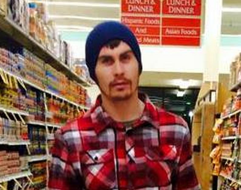 Troopers arrested Kodiak man, Bryce Beltran, wanted on two-$25,000 warrants stemming from March incident.