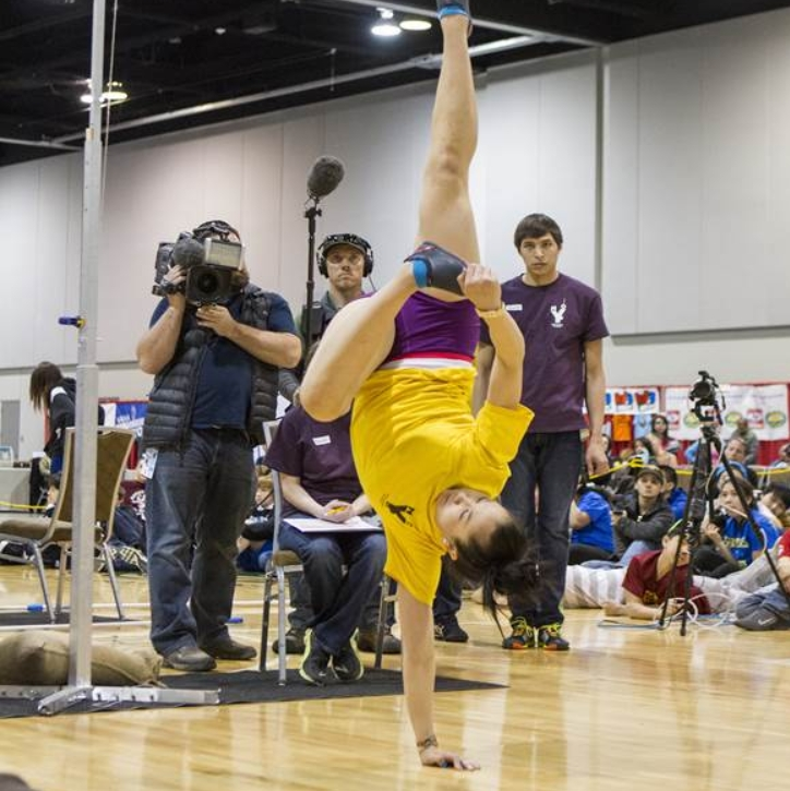 Autumn Ridley of Anchorage performs in the Alaskan High Kick during the 2014 NYO Games at the Dena'ina Center in Anchorage. Autumn broke the world record in the event with a kick of 83 inches. PHOTO BY WAYDE CARROLL