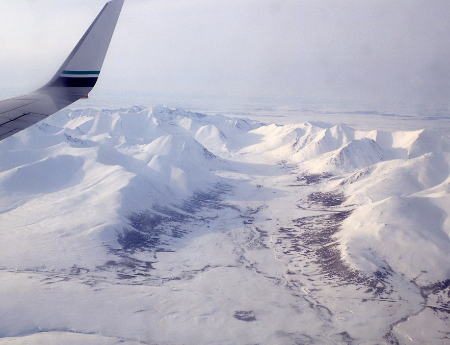 A window-seat view of the Grand Central River valley, within the Kigluaik Mountains north of Nome. Ned Rozell and his friends would ski the road (visible at bottom) on the last day of a trip from Shishmaref to Nome. Ned Rozell