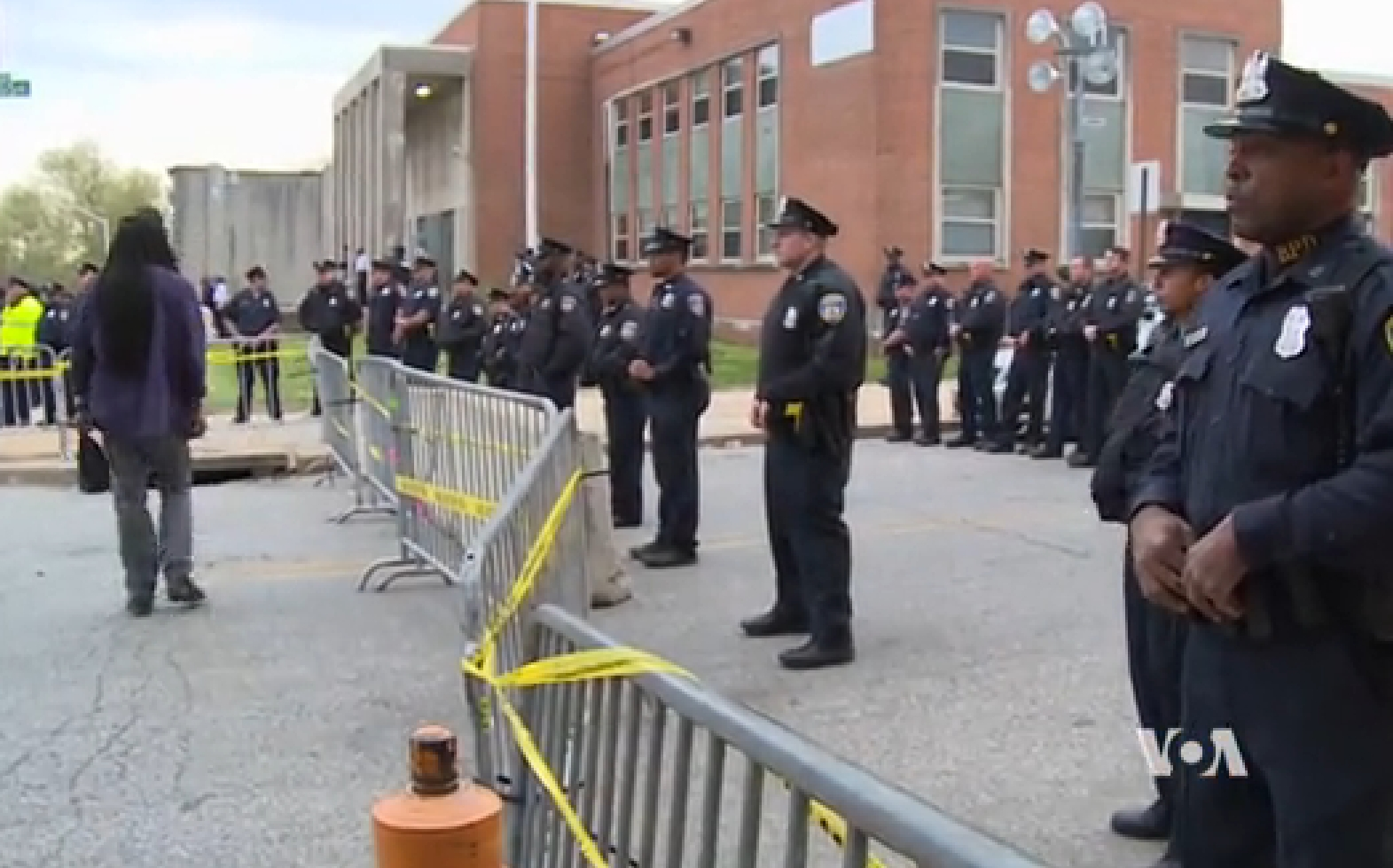Baltimore police standing guard outside of the Baltimore Police Station during protests. Image-VOA