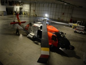 A Coast Guard MH-60 Jayhawk helicopter from Air Station Kodiak, Alaska, rests in the Deadhorse Aviation Center hangar in Prudhoe Bay.(U.S. Coast Guard photo by Petty Officer 1st Class Shawn Eggert)