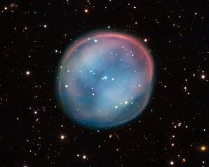 This extraordinary bubble, glowing like the ghost of a star in the haunting darkness of space, may appear supernatural and mysterious, but it is a familiar astronomical object: a planetary nebula, the remnants of a dying star. Image-ESO
