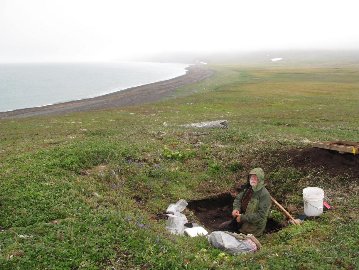 "In August 2012, Dennis Griffin examines ""the Pottery House"" on St. Matthew Island, the land farthest from a village in Alaska. Ned Rozell photo."