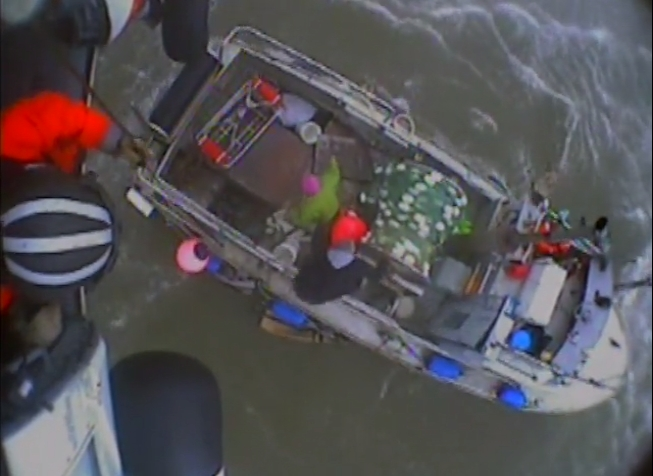 A Coast Guard MH-60 Jayhawk helicopter crew rescues two mariners from the disabled fishing vessel Yo Yo near Togiak, Alaska, Aug. 9, 2015. The man and woman were taken safely to Togiak. U.S. Coast Guard
