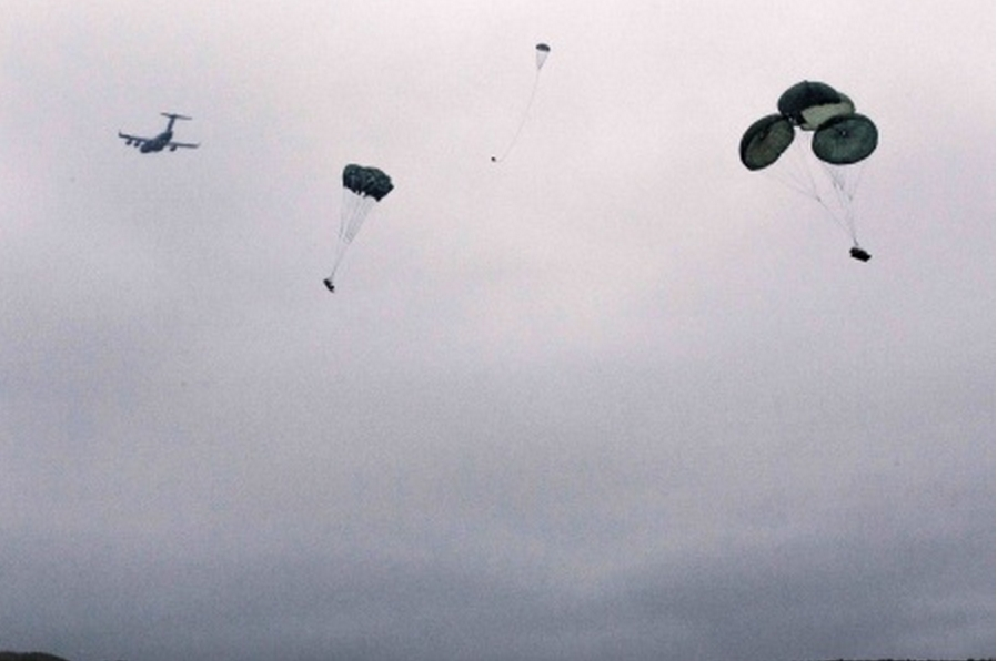 An Alaska Air National Guard C-17 Globemaster III with the 249th Airlift Squadron drops two small unit support vehicles and supporting equipment during a joint airdrop operation performed at Malamute Drop Zone, Joint Base-Elmendorf-Richardson, Sept. 15.(U.S. Army National Guard photo by Sgt. Marisa Lindsay)