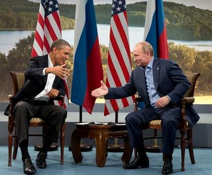 Putin and Obama shake hands at G8 summit, June 17, 2013