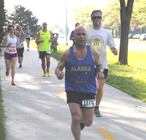 Command Sgt. Maj. Marc Petersen represents the Alaska Army National Guard in the 2015 Lincoln marathon held in Lincoln, Neb., in May. Petersen has completed more than 10 half-marathons, 17 marathons, and two Ultra marathons; he hopes to run as long as he can. (Courtesy photo by the Nebraska National Guard)