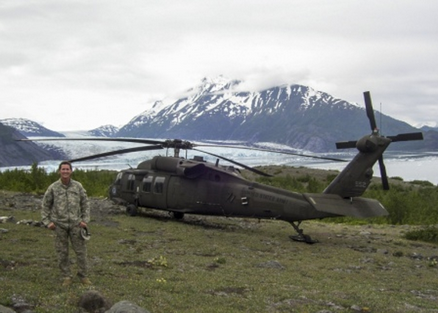 Alaska Guardsman Chief Warrant Officer 4 Pamela Vitt, the command chief warrant officer for the Alaska Army National Guard, stands in front of a UH-60 Black Hawk helicopter near Colony Glacier while supporting a wreckage recovery mission in June. (Photo courtesy Chief Warrant Officer 4 Pamela Vitt)