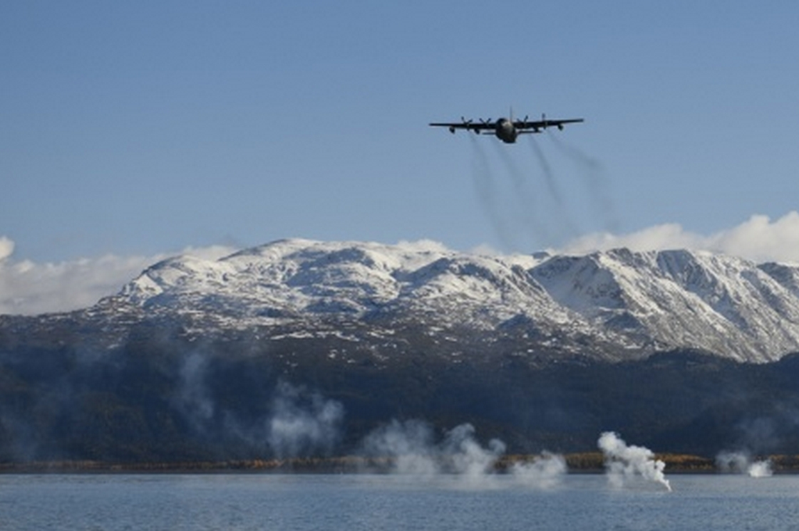 An HC-130 from the 211th Rescue Squadron drops signal flares in Homer's inner bay as part of rescue water training Sept. 30. (U.S. Air National Guard photo by Tech. Sgt. N. Alicia Halla)