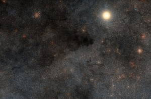 This rich landscape is part of the small constellation of Crux (The Southern Cross). The very bright star is Alpha Crucis, also know as Acrux, one of the four stars that make up the famous cross shape. Most of the upper left part of this image is filled with dark dusty clouds that form part of the huge dark nebula called the Coalsack.  Credit: ESO/Digitized Sky Survey 2. Acknowledgment: Davide De Martin