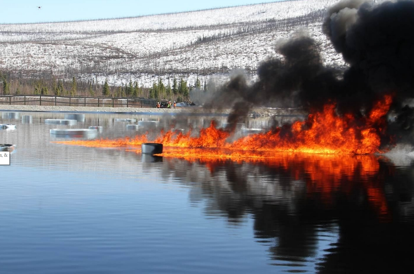 Oil burns on a manmade water basin at Poker Flat Research Range in April 2015. Photo by Len Zabilansky.