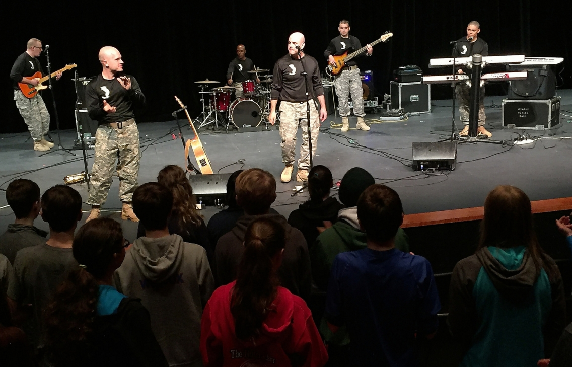 Members of the 9th Army Band's Vernal Equinox rock band perform for Sitka High School students Oct. 15 during and early-morning concert in Sitka, Alaska. The U.S. Army Alaska Soldiers performed at a total of five area elementary, middle and high schools while they were in town supporting the Alaska Day Festival. (Photo by Mary M. Rall/U.S. Army Alaska Public Affairs)
