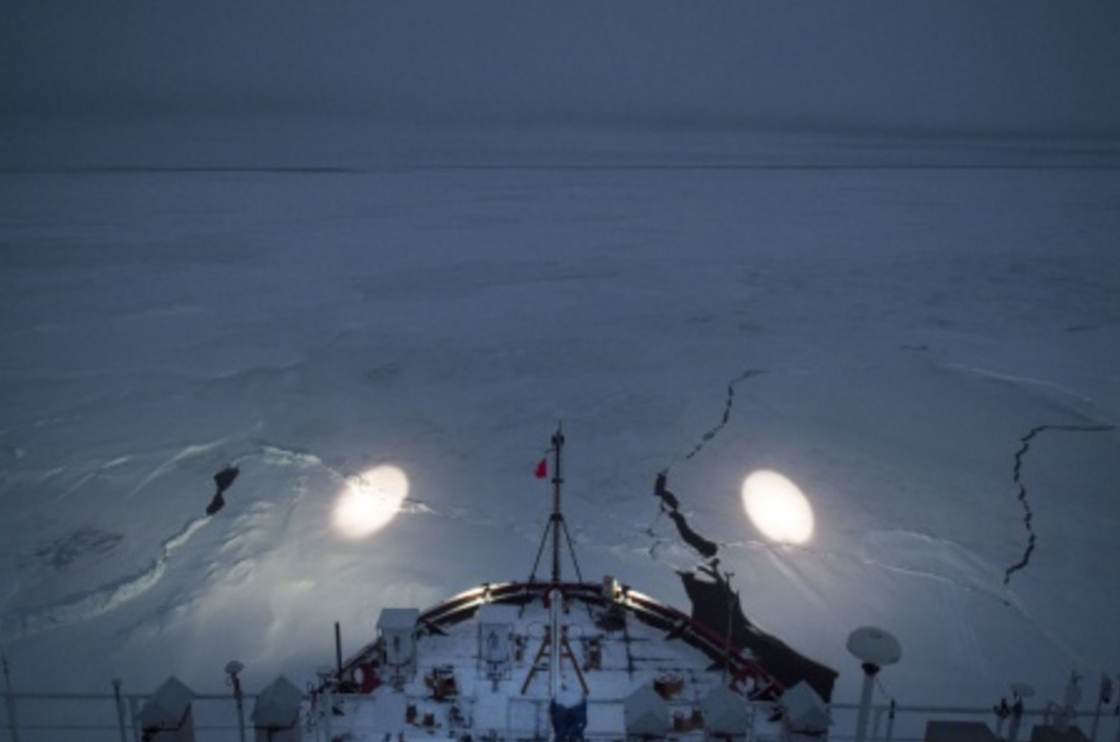 Coast Guard Cutter Healy crew members use spotlights while navigating through ice Sept. 20, 2015, while underway in the Arctic Ocean. (U.S. Coast Guard photo by Petty Officer 2nd Class Cory J. Mendenhall)