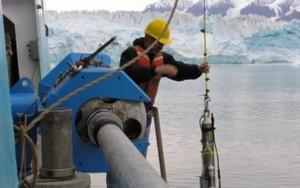 Scientists obtain ocean salinity and temperature readings near Hubbard Glacier, Alaska. Credit: SE Alaska Scientific Party