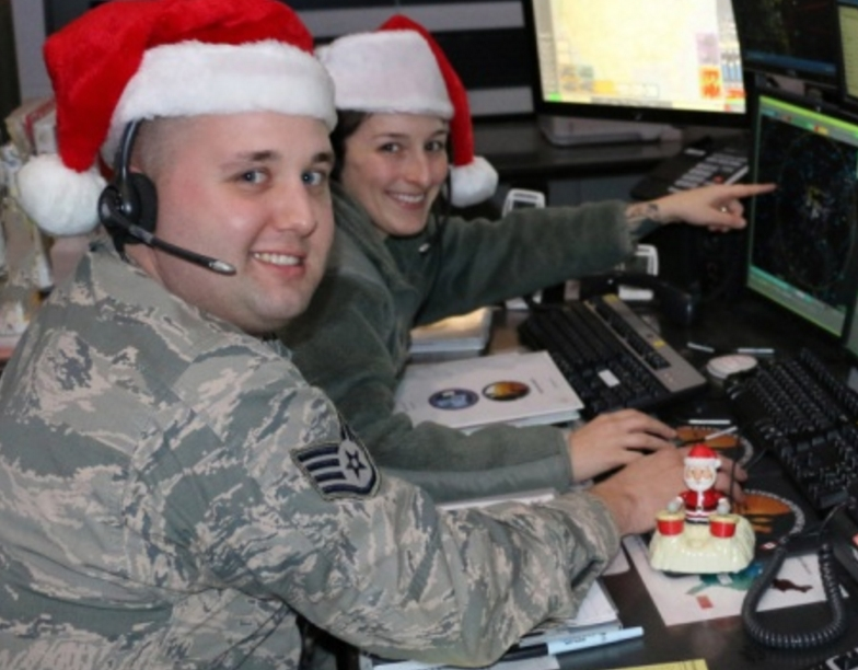 Staff Sgt. Tom Silva and Staff Sgt. Rachael Alcorta practice Santa tracking at the Eastern Air Defense Sector in Rome. EADS plays a supporting role in NORAD's annual Santa tracking.