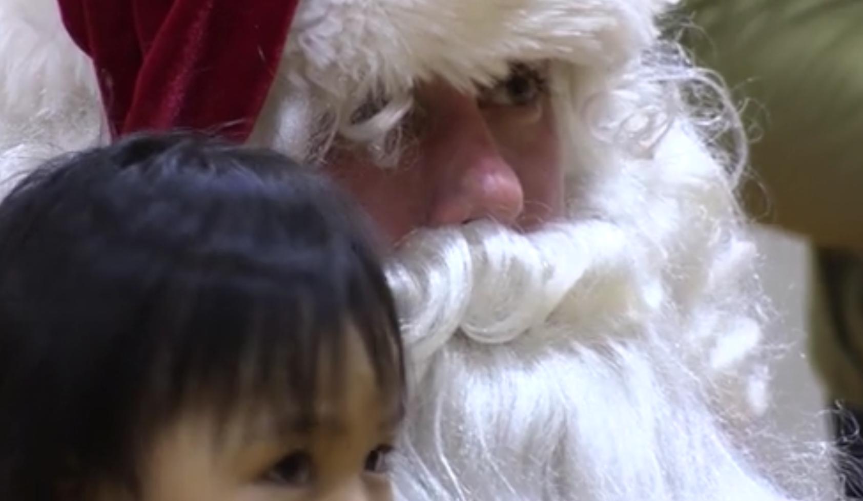 Santa visiting with children in rural Alaska. Image-USMC