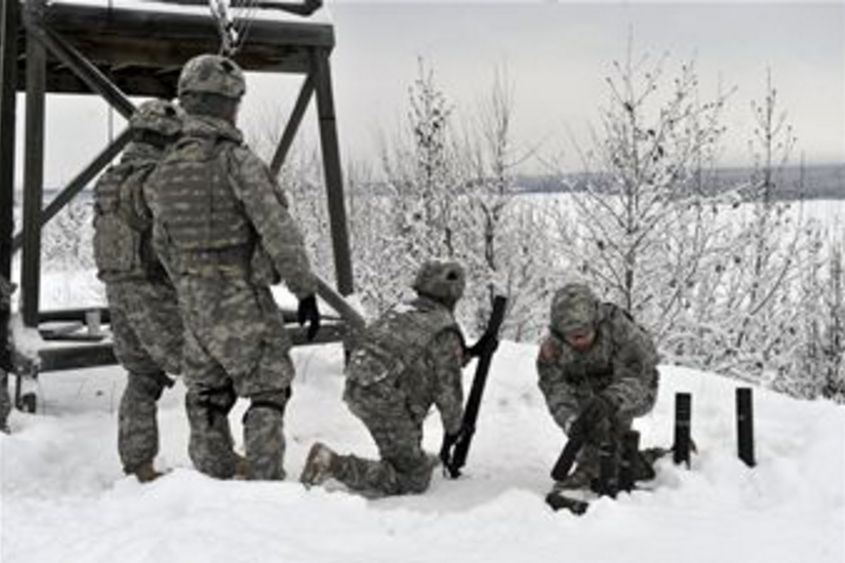 JBER troopers training with live mortars in February 2013. Image JBER