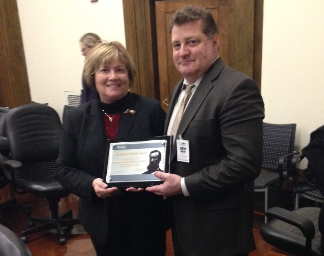 Nicholas Mastrodicasa is presented the Henry Gannett Award by Suzette Kimball, Director of the U.S. Geological Survey
