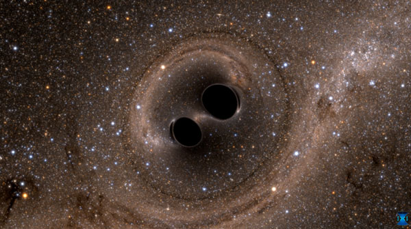 The collision of two black holes -- an event detected for the first time ever by the Laser Interferometer Gravitational-Wave Observatory, or LIGO -- is seen in this still from a computer simulation. Image credit: SXS