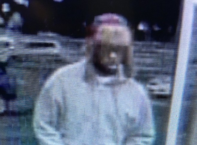 Anchorage police are seeking information on the man pictured above for the robbery of the DeBarr Walmart on Monday morning. Image-Anchorage Police Department
