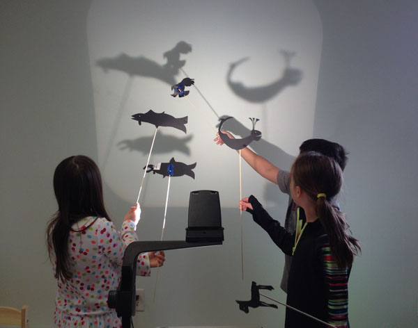 Sitka elementary students demonstrating shadow puppets made in an afternoon session with artist -in-residence Kimi Eisele. Image-The Island Institute