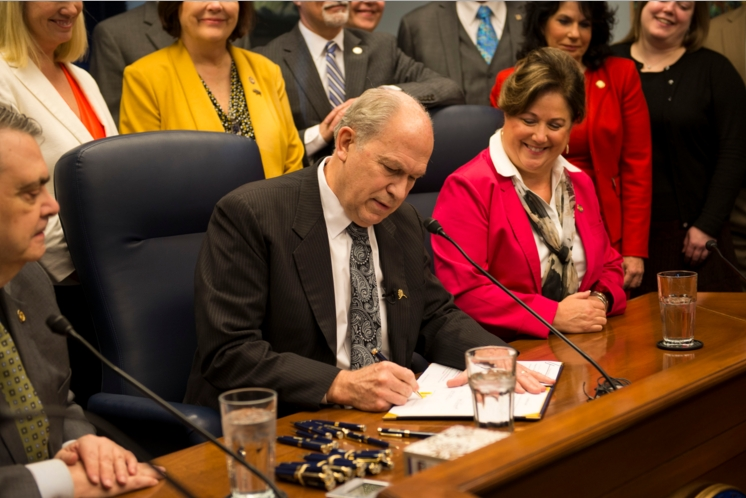 """Governor Walker signing SB23, dubbed the """"Overdose Prevention Bill,"""" into law. Image-State of Alaska"""