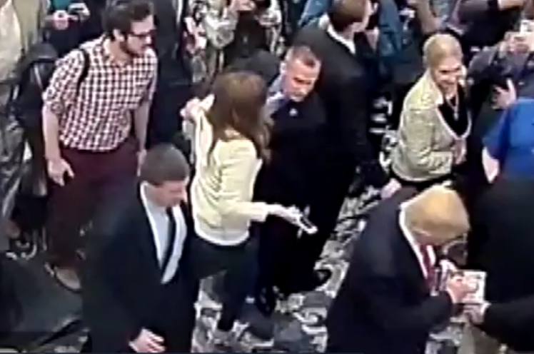Image showing Fields being grabbed by Lewandowski. Image-Security camera video screengrab