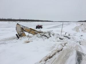 Excavator submerged in Qinaq River.(Photo/Carl McIntyre )