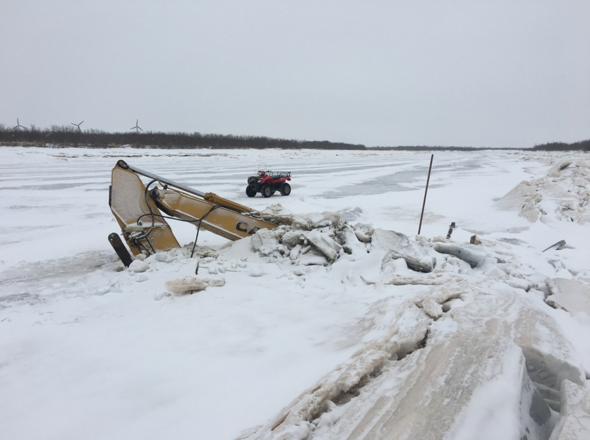 Excavator submerged in Qinaq River.(Photo/Carl McIntyre )
