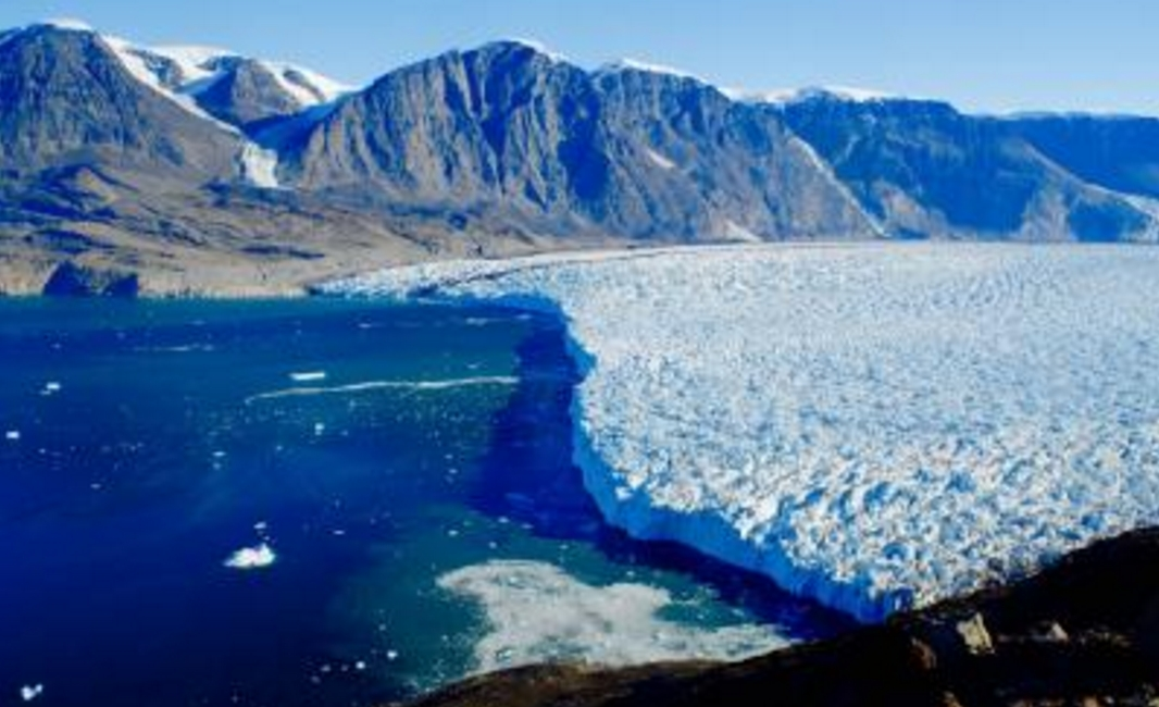 Dartmouth College scientists have found that surface meltwater draining through and underneath Greenland tidewater glaciers is accelerating their loss of ice mass. Image-Dartmouth College