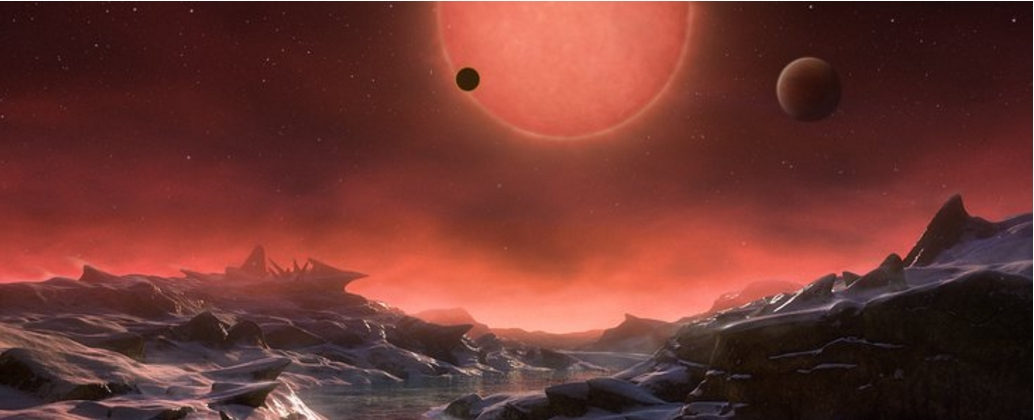 This artist's impression shows an imagined view from the surface one of the three planets orbiting an ultracool dwarf star just 40 light-years from Earth that were discovered using the TRAPPIST telescope at ESO's La Silla Observatory. Credit: ESO/M. Kornmesser