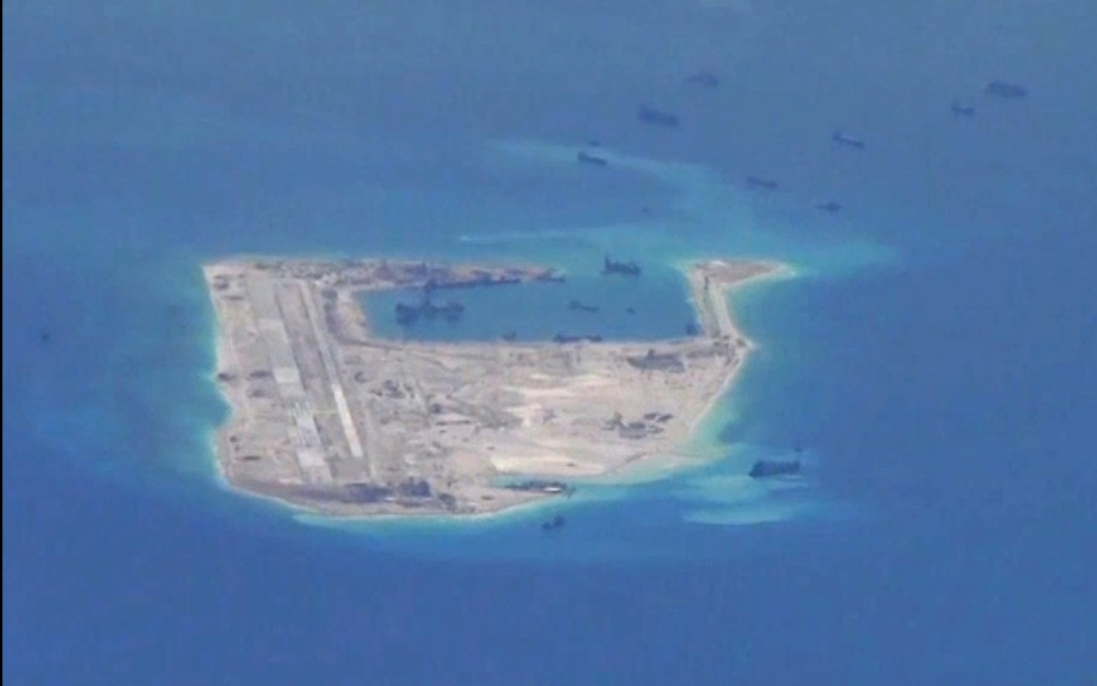 Chinese dredging vessels seen around Fiery Cross Reef in the Spratly Islands in image taken by U.S. Navy P-8A Poseidon aircraft. Navy Handout via Reuters
