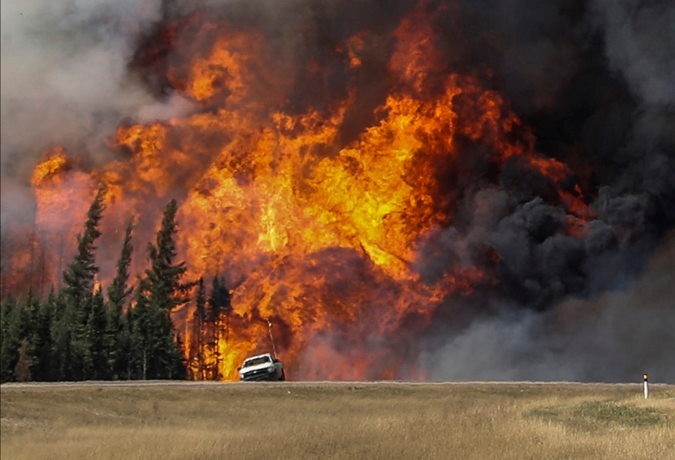 A wildfire burns north of Fort McMurray, Alberta, Canada. Reuters/Chris Wattie/File photo