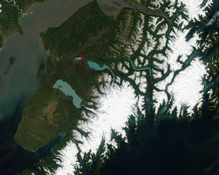 An image of the Kenai Peninsula on June 15, 2015, acquired from the Moderate Resolution Imaging Spectroradiometer aboard the Aqua satellite. The red box in this cropped image is a wildfire. Image credit: Jeff Schmaltz, NASA.