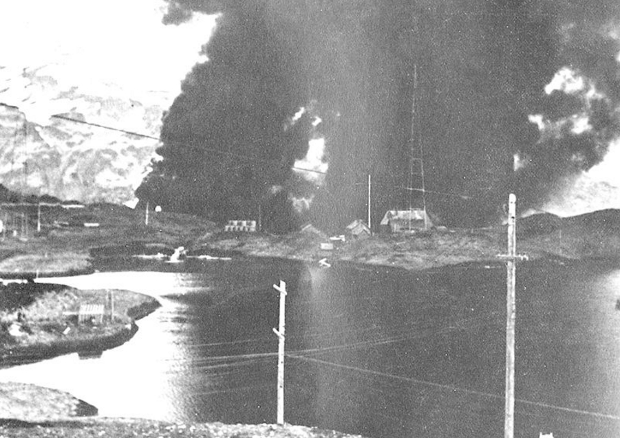 The Navy radio station at Dutch Harbor burning after the Japanese Attack, 4 June 1942. Image-United States Army Air Forces