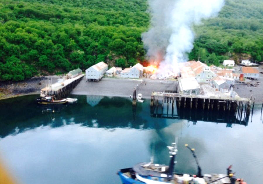 Responders assess a fire at the Park's Cannery near Uyak Bay on Kodiak Island, Alaska, June 2, 2016. The Coast Guard launched an MH-60 Jayhawk helicopter crew to assist with rescue efforts. U.S. Coast Guard photo.