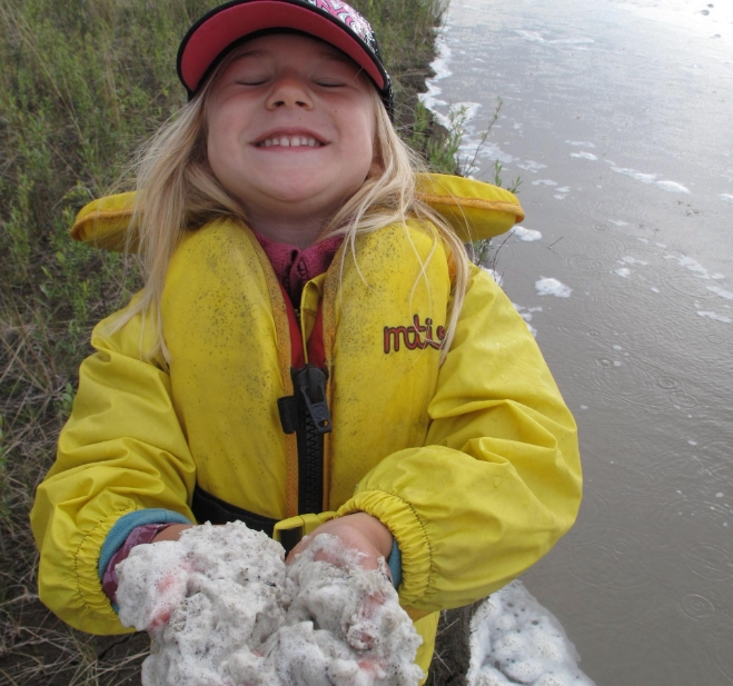 A girl with foam that was floating on the Tanana River. Photo by Ned Rozell.