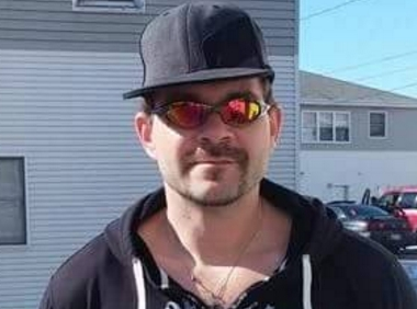 36-year-old John Bass was arrested on an Escape warrant on Sunday, troopers reported. Image-Facebook profile